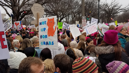 riot: WASHINGTON, DC - JANUARY 21, 2017: Protesters hold up anti-Trump signs as thousands participate in the Womens March on Washington for social justice, the day after the Presidential Inauguration.