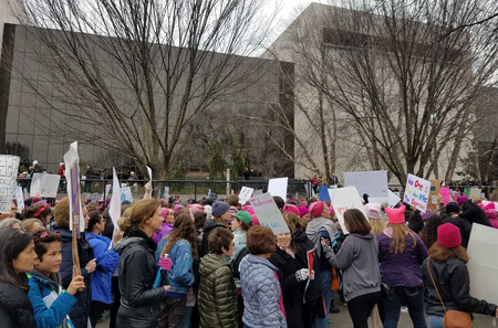 marchers: WASHINGTON, DC - JANUARY 21, 2017: Protesters hold up anti-Trump signs as thousands participate in the Womens March on Washington for social justice, the day after the Presidential Inauguration.