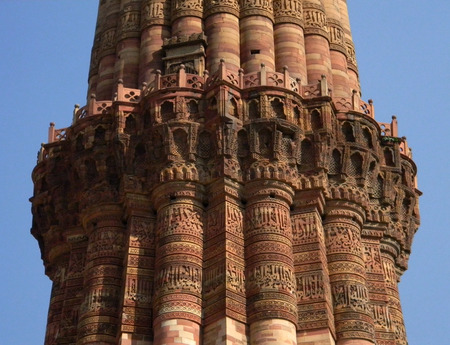 The Qutub Minar monument site details of architecture with masonry carvings in brick and sandstone. Фото со стока