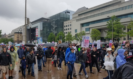 WASHINGTON, DC - JANUARY 21, 2017 Protesters hold signs signalling their support for science and their opposition to the Trump administration and the Republican policies targeting scientific research, as thousands participate in the March for Science, a g
