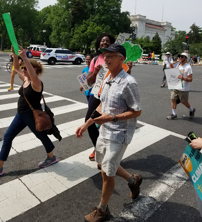 WASHINGTON, DC - APRIL 29, 2017 Protesters hold signs in support of climate justice and scientific research, as thousands participate in the Peoples Climate Movement March. Editöryel