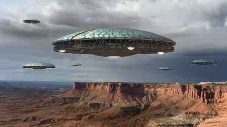 Alien spaceship fleet above the Grand Canyon, in Canyonlands, Utah, USA, for futuristic, fantasy and interstellar travel or war game backgrounds. Foto de archivo
