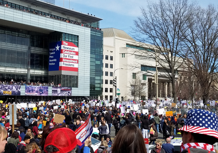 WASHINGTON, DC, USA - MARCH 24, 2018: People participate in the March For Our Lives, a student-led rally, demand an end to gun violence and for responsible firearm control legislation.