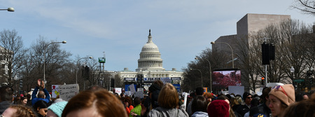 WASHINGTON, DC, USA - MARCH 24, 2018: People demonstrate in the March For Our Lives, a student-led rally, demanding an end to gun violence and responsible firearm control legislation.