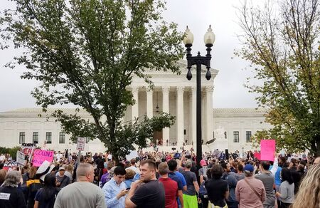WASHINGTON, DC  - OCTOBER 06, 2018: People hold signs and rally at the Supreme Court to protest the nomination and the Senate vote for the next Associate Justice.