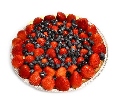 Red, white, and blue fruit tart with strawberries and blueberries Imagens