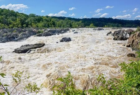 The Potomac river waters swollen by heavy rains, rushing in the Great Falls, in Maryland, USA