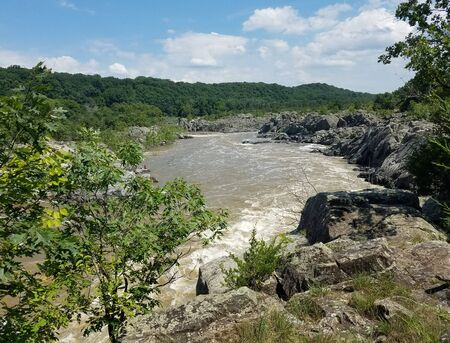 The Potomac river rapids swollen by heavy rains, at the Great Falls, in Virginia, USA