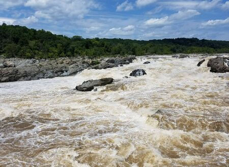 The Potomac river waters swollen by heavy rains, at the Great Falls, in Maryland, USA
