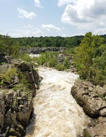 The Potomac river rushing waters swollen by heavy rains, at the Great Falls, in Maryland, USA 写真素材