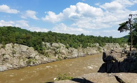 The Potomac river swollen by heavy rains, along the Great Falls rock cliffs, in Virginia, USA