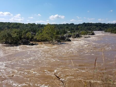 The Potomac river rapids swollen by heavy rains, at the Great Falls, in Maryland, USA