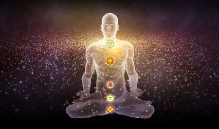 Silhouette in an enlightened Yoga meditation pose with the Hindu Chakras overlapping a galaxy of stars. Stock Photo