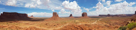 Monument Valley landscape panorama with a winding road among mesa rock formations, on the Arizona-Utah border, USA 写真素材