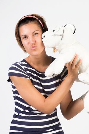 plush: beautiful girl kissing plush Stock Photo