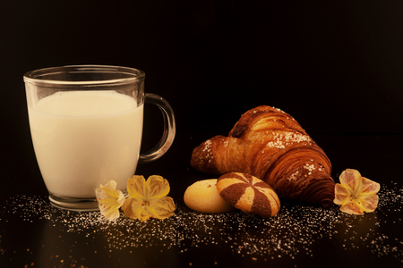 delicious breakfast with fresh croissants on wooden table milk