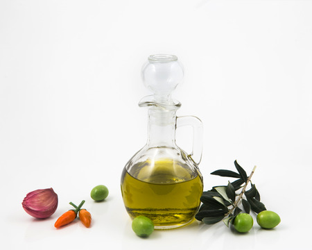 blake and white: bottle with olive oil isolated on white background and, garlic peppers Stock Photo