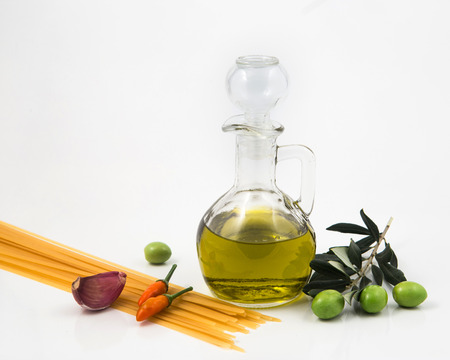 additional: bottle with olive oil isolated on white background and, garlic peppers Stock Photo