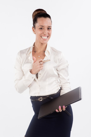 chignon: Businesswoman holding a briefcase full length Stock Photo