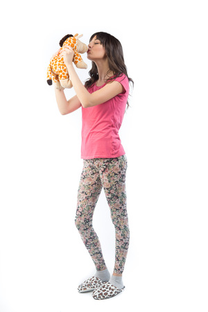 Portrait of cute girl with a soft toy in the hands isolated on white background