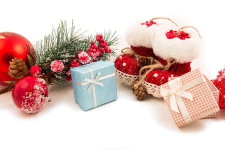 Gift packages and Christmas-colored accessories isolated on white