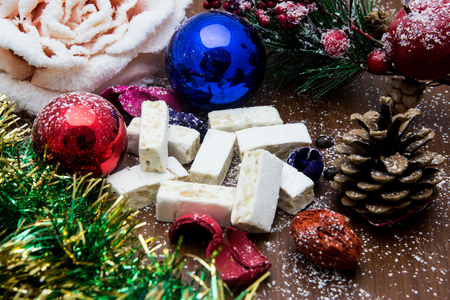 Nougat, traditional Spanish sweet for Christmas. sweet almond nougat dark background