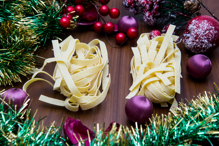 fettuccine: fettuccine pasta with various Christmas decorations