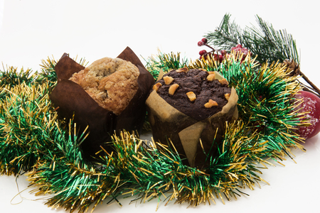 pine wreaths: Christmas still life with ginger honey muffins, ornaments, pine, shoes, gift, wreaths chocolate candy on a wooden background