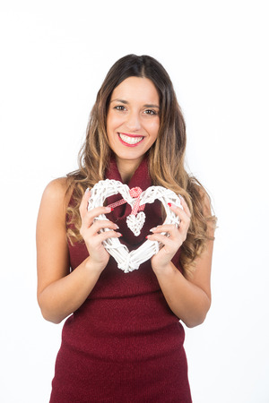st valentin: Beautiful young happy woman hold love symbol heart saint valentine day, isolated on white background