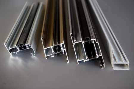 protruded aluminum profile for windows and doors manufacturing .selective focus