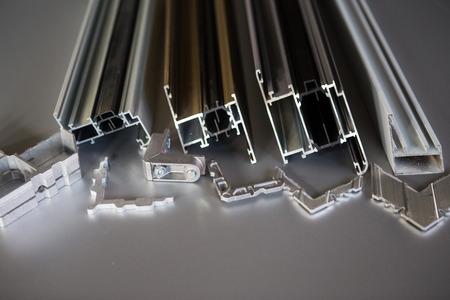 aluminum: protruded aluminum profile for windows and doors manufacturing .selective focus