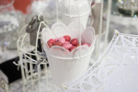 sugared almonds: heap of red sugared almonds