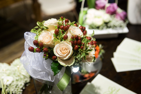 beautiful wedding bouquet of bright flowers in basket on table Stock Photo