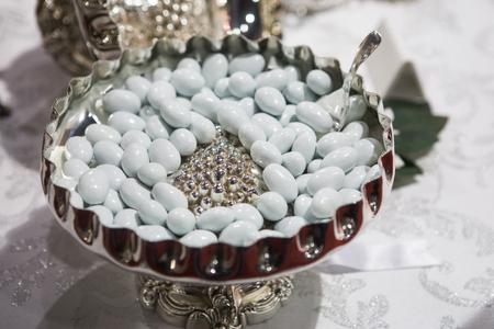 sugared almonds: heap of white sugared almonds