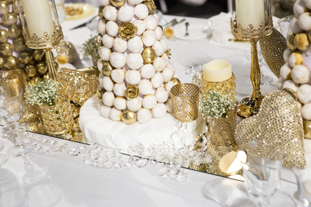 Blue wedding cake with edible gold leaf Stock Photo