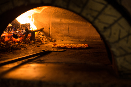 Pizza cooking in the oven to tradition