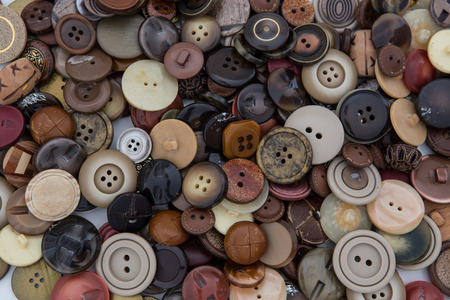 beautiful collection of various sewing button on white background.