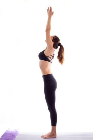 Young smiling woman practicing yoga, white background, Stock Photo