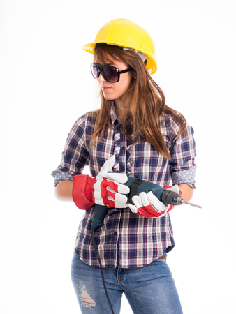 architect tools: beautiful young lady worker with a pneumatic drilling machine isolated on white