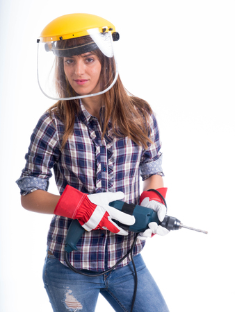 beautiful young lady worker with a pneumatic drilling machine isolated on white