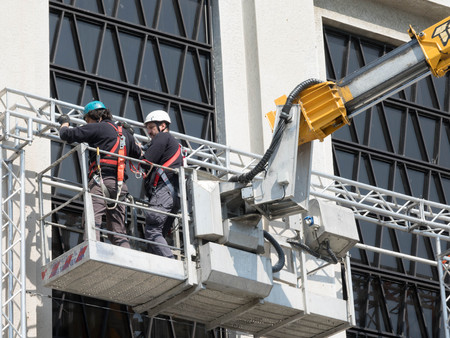 TRIESTE, ITALY - APRIL 23, 2017 Worker on aerial access platform, Preparation show