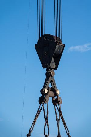 Vintage crane hook with blue sky backgrounds