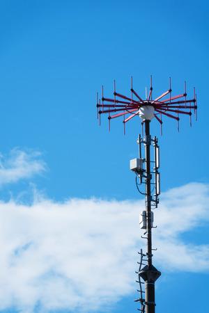 Marine antenna on a background of blue sky