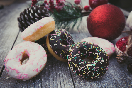 homemade sweet donuts with Christmas decorations, on a wooden board