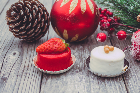 An array of Christmas desserts with colorful, on wooden board Reklamní fotografie