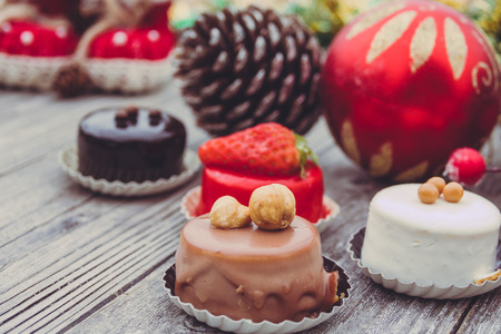An array of Christmas desserts with colorful, on wooden board Stock Photo