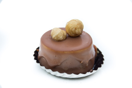 Dessert - sweet cake with hazelnuts, isolated on white background Reklamní fotografie