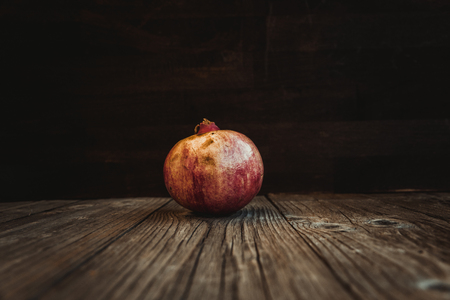 Pomegranate. Fresh raw fruit on a wooden board