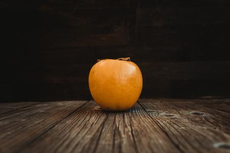 Delicious fresh persimmon fruit on a wooden board Reklamní fotografie