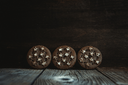 Chocolate cookies with stars, on a wooden board